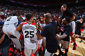 Denzel Valentine of the Chicago Bulls celebrates with his teammates after hitting the game winning shot against the Minnesota Timberwolves during the...