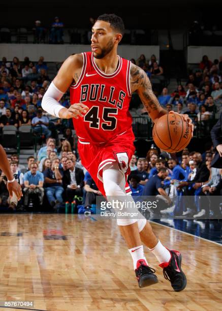 Denzel Valentine of the Chicago Bulls handles the ball against the Dallas Mavericks during the preseason game on October 4 2017 at the American...
