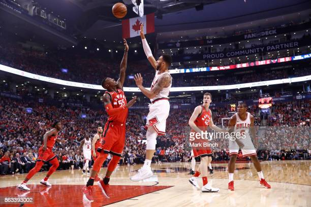 Denzel Valentine of the Chicago Bulls shoots the ball against Delon Wright of the Toronto Raptors during the game on October 19 2017 at the Air...