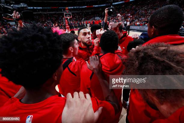 Denzel Valentine of the Chicago Bulls with his teammates huddle before the game against the Atlanta Hawks on October 26 2017 at the United Center in...
