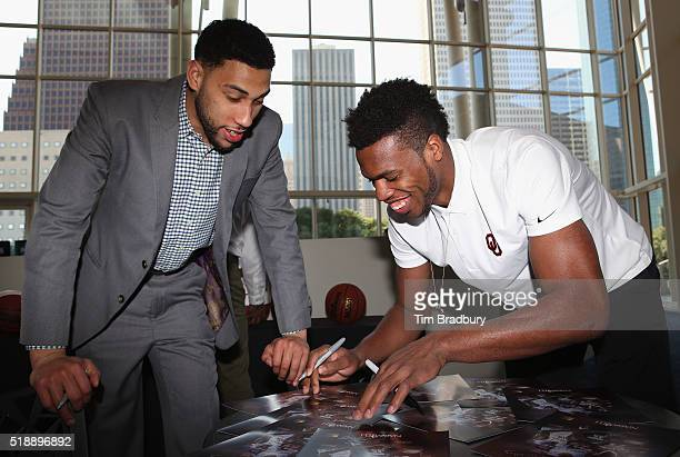 Denzel Valentine of the Michigan State Spartans and Buddy Hield of the Oklahoma Sooners autograph posters during the 2016 Naismith Awards Brunch at...