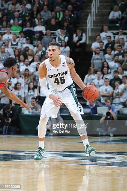 Denzel Valentine of the Michigan State Spartans brings the ball up the court during the game against Florida Atlantic Owls at the Breslin Center on...