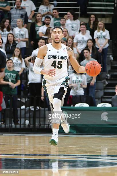 Denzel Valentine of the Michigan State Spartans brings the ball up the court in the second half against the ArkansasPine Bluff Golden Lions at the...