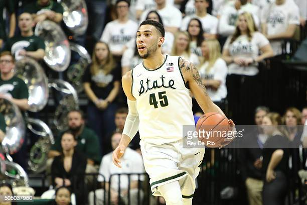 Denzel Valentine of the Michigan State Spartans brings the ball up the court in the second half against the Iowa Hawkeyes at the Breslin Center on...
