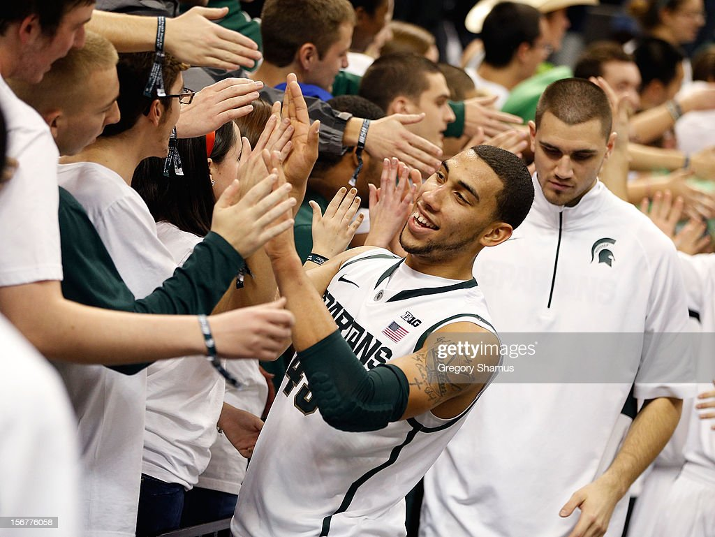 Denzel Valentine #45 of the Michigan State Spartans celebrates a 74-70 win over the Boise State Broncos with the student section at the Breslin Center on November 20, 2012 in East Lansing, Michigan.