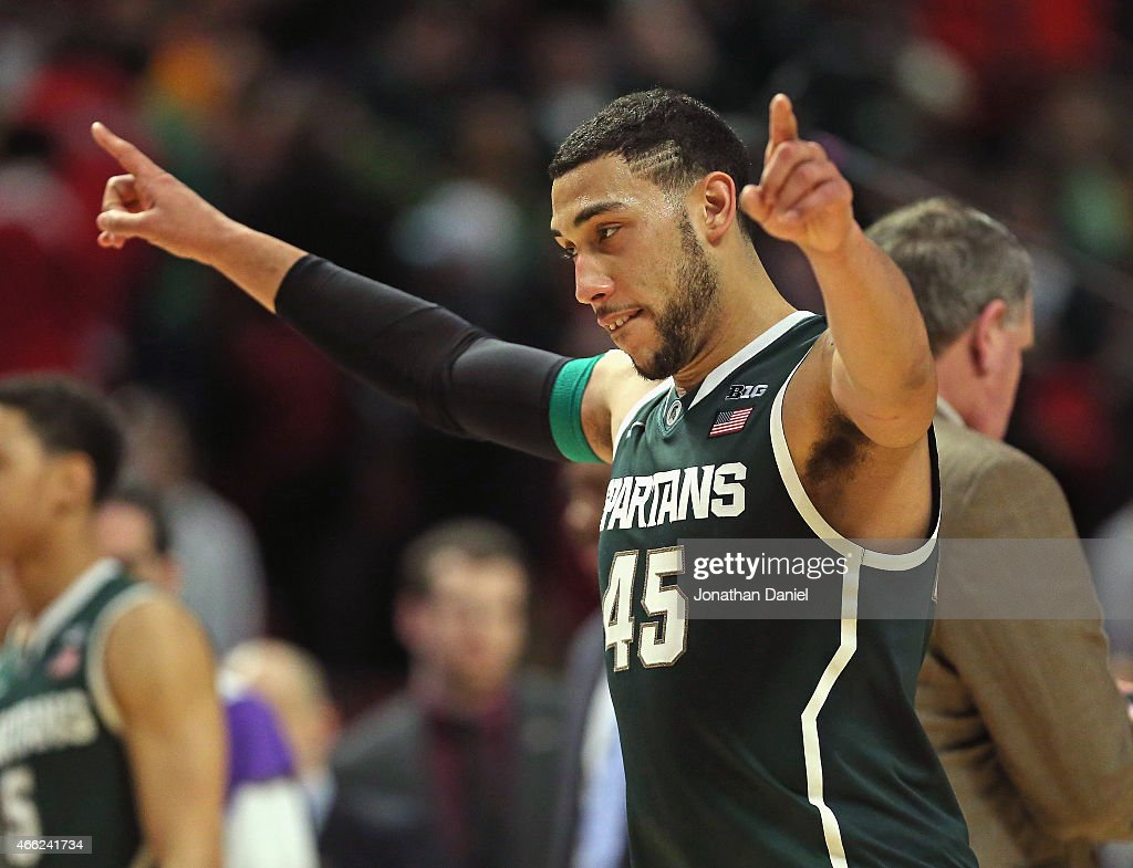 Denzel Valentine of the Michigan State Spartans celebrates a win over the Maryland Terrapins during the semifinal round of the 2015 Big Ten Men's...