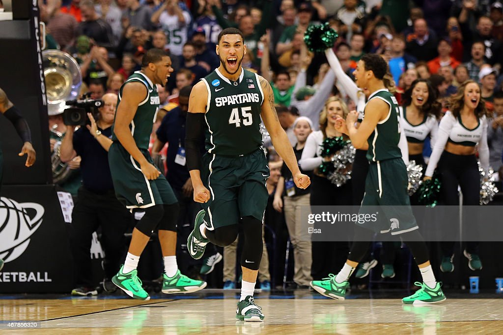 <a gi-track='captionPersonalityLinkClicked' href=/galleries/search?phrase=Denzel+Valentine&family=editorial&specificpeople=9980674 ng-click='$event.stopPropagation()'>Denzel Valentine</a> #45 of the Michigan State Spartans celebrates after defeating the Oklahoma Sooners 62 to 58 during the East Regional Semifinal of the 2015 NCAA Men's Basketball Tournament at the Carrier Dome on March 27, 2015 in Syracuse, New York.