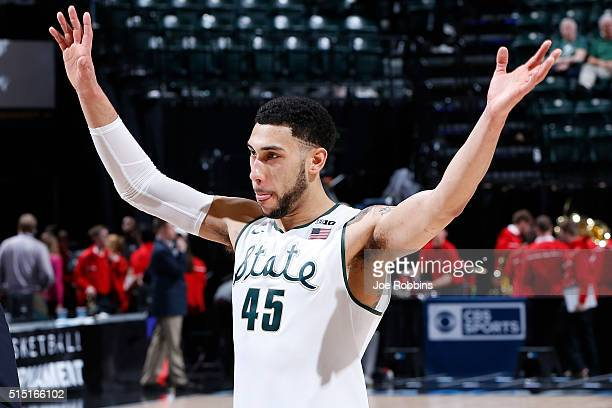Denzel Valentine of the Michigan State Spartans celebrates after defeating the Maryland Terrapins in the semifinals of the Big Ten Basketball...