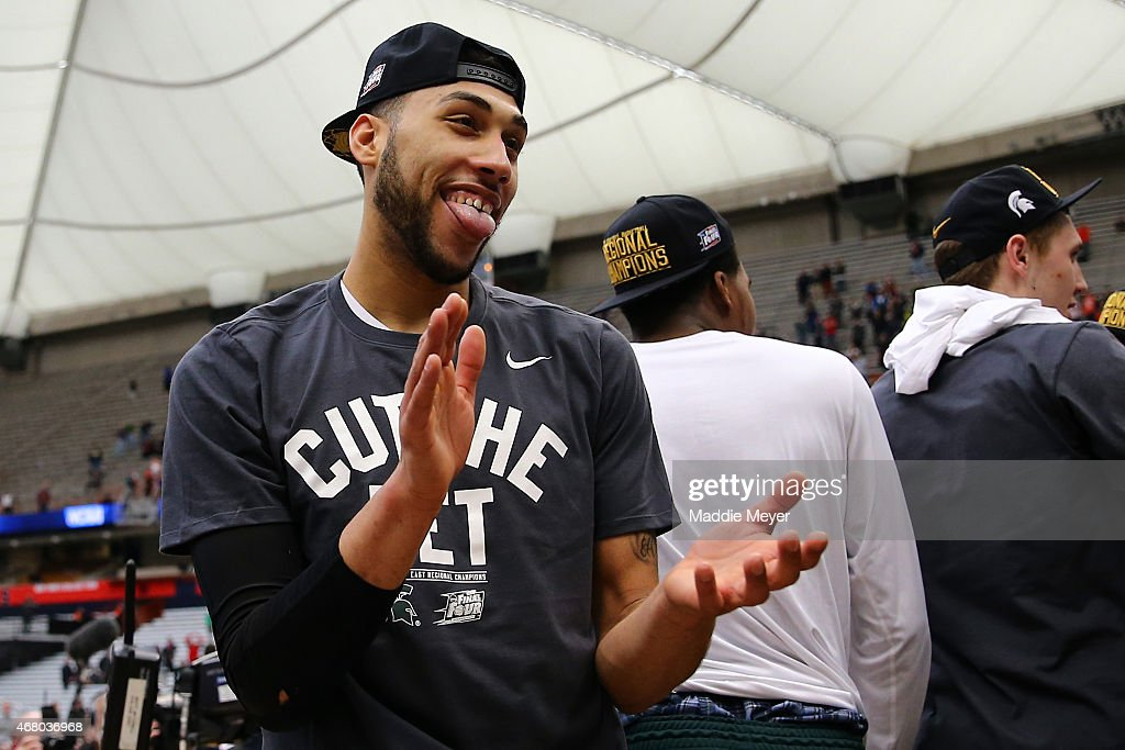 <a gi-track='captionPersonalityLinkClicked' href=/galleries/search?phrase=Denzel+Valentine&family=editorial&specificpeople=9980674 ng-click='$event.stopPropagation()'>Denzel Valentine</a> #45 of the Michigan State Spartans celebrates defeating the Louisville Cardinals 76 to 70 in overtime of the East Regional Final of the 2015 NCAA Men's Basketball Tournament at Carrier Dome on March 29, 2015 in Syracuse, New York.