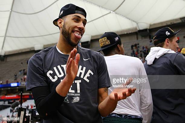 Denzel Valentine of the Michigan State Spartans celebrates defeating the Louisville Cardinals 76 to 70 in overtime of the East Regional Final of the...