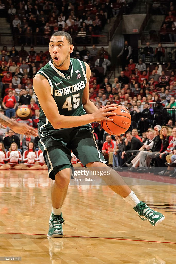 Denzel Valentine #45 of the Michigan State Spartans controls the ball against the Ohio State Buckeyes on February 24, 2013 at Value City Arena in Columbus, Ohio.