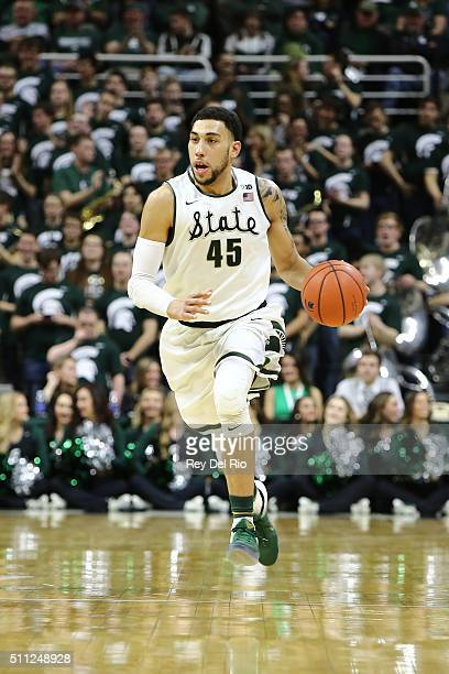 Denzel Valentine of the Michigan State Spartans dribbles the ball up the court during the game against the Wisconsin Badgers in the second half at...