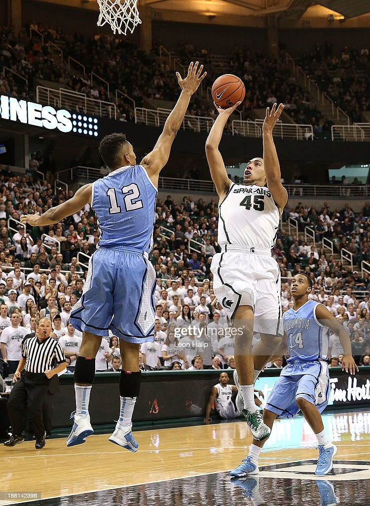 Denzel Valentine #45 of the Michigan State Spartans drives the ball to the basket as Maodo Lo #12 of the Columbia Lions during the second half of the game at Breslin Center on November 15, 2013 in East Lansing, Michigan. Michigan State defeated Columbia 62-53.