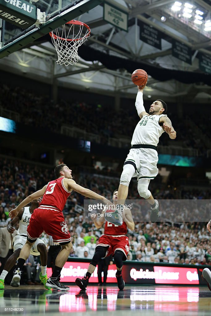 <a gi-track='captionPersonalityLinkClicked' href=/galleries/search?phrase=Denzel+Valentine&family=editorial&specificpeople=9980674 ng-click='$event.stopPropagation()'>Denzel Valentine</a> #45 of the Michigan State Spartans dunks the ball during the game against the Wisconsin Badgers in the second half at the Breslin Center on February 18, 2016 in East Lansing, Michigan.