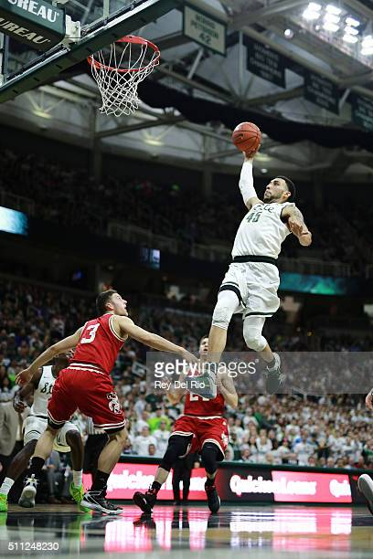 Denzel Valentine of the Michigan State Spartans dunks the ball during the game against the Wisconsin Badgers in the second half at the Breslin Center...