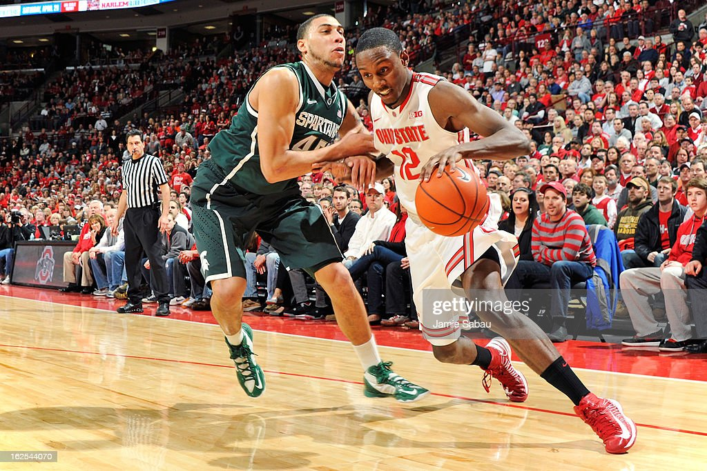 Denzel Valentine #45 of the Michigan State Spartans fouls Sam Thompson #12 of the Ohio State Buckeyes along the baseline in the second half on February 24, 2013 at Value City Arena in Columbus, Ohio. Ohio State defeated Michigan State 68-60.