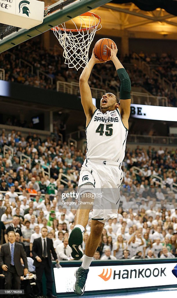 Denzel Valentine #45 of the Michigan State Spartans gets to the basket for a dunk while playing the Boise State Broncos at the Breslin Center on November 20, 2012 in East Lansing, Michigan. Michigan State won the game 74-70.