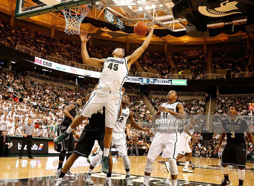Denzel Valentine #45 of the Michigan State Spartans grabs a first half rebound while playing the Purdue Boilermakers at the Jack T. Breslin Student Events Center on January 5, 2013 in East Lansing, Michigan. Michigan State won the game 84-61.