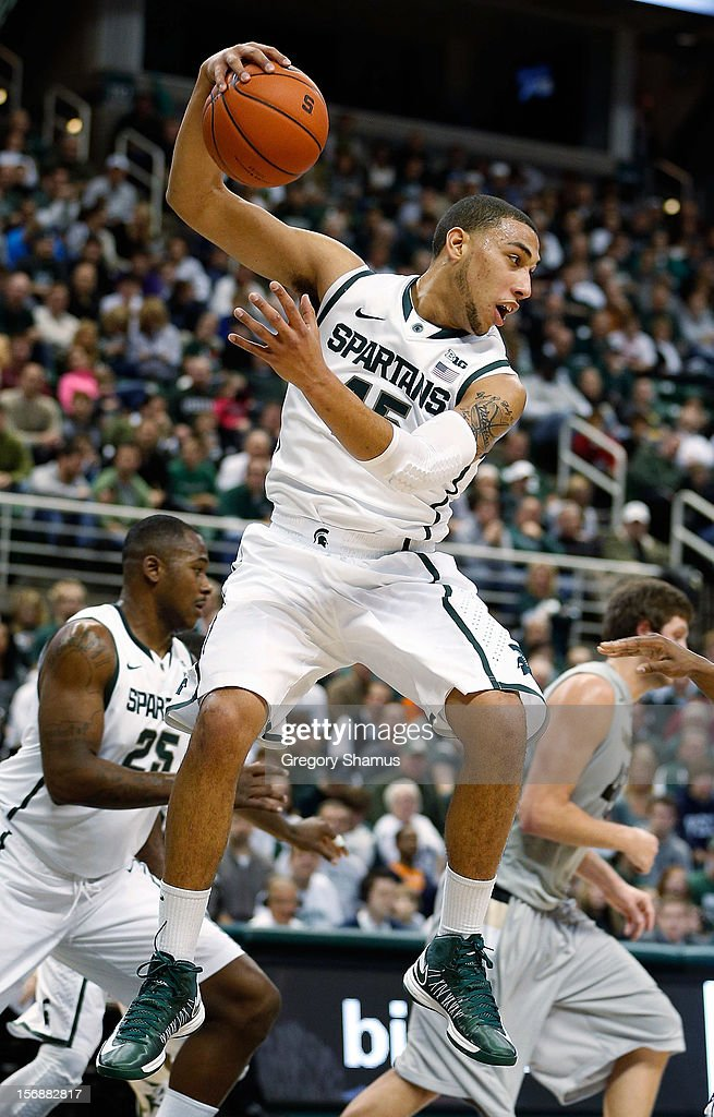 Denzel Valentine #45 of the Michigan State Spartans grabs a fist half rebound while playing the Oakland Golden Grizzlies at the Jack T. Breslin Students Events Center on November 23, 2012 in East Lansing, Michigan.