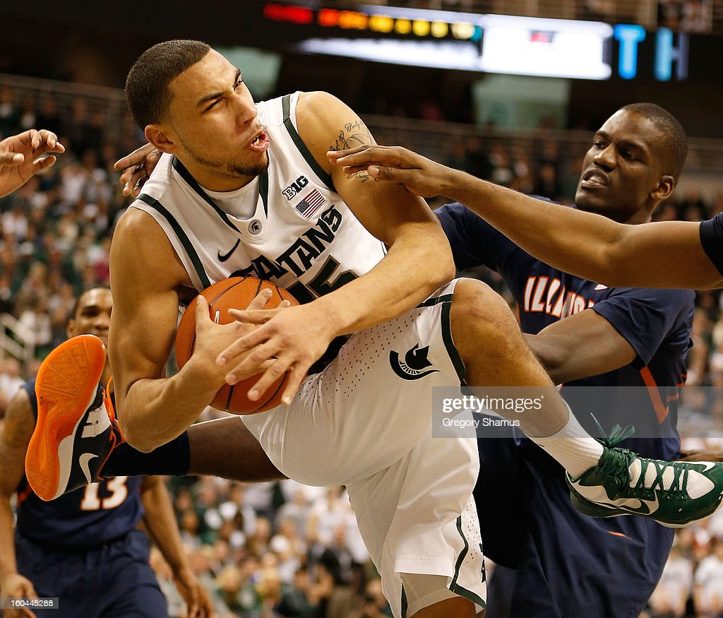 Denzel Valentine #45 of the Michigan State Spartans grabs a second half rebound next to Nnanna Egwu #32 of the Illinois Fighting Illini at the Jack T. Breslin Student Events Center on January 31, 2013 in East Lansing, Michigan. Michigan State won the game 80-75.