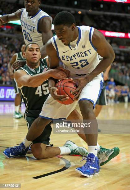 Denzel Valentine of the Michigan State Spartans grabs Alex Poythress of the Kentucky Wildcats during the State Farm Champions Classic at the United...