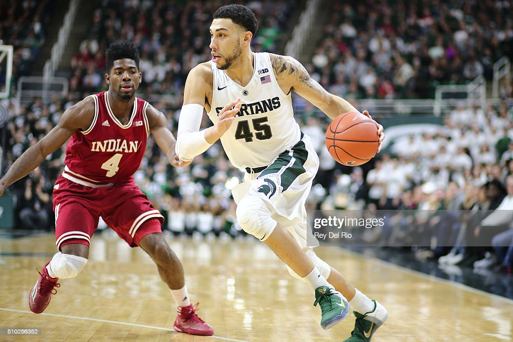 <a gi-track='captionPersonalityLinkClicked' href=/galleries/search?phrase=Denzel+Valentine&family=editorial&specificpeople=9980674 ng-click='$event.stopPropagation()'>Denzel Valentine</a> #45 of the Michigan State Spartans handles the ball under pressure from Robert Johnson #4 of the Indiana Hoosiers in the second half at the Breslin Center on February 14, 2016 in East Lansing, Michigan.