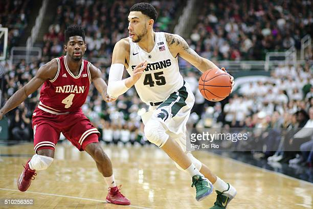 Denzel Valentine of the Michigan State Spartans handles the ball under pressure from Robert Johnson of the Indiana Hoosiers in the second half at the...