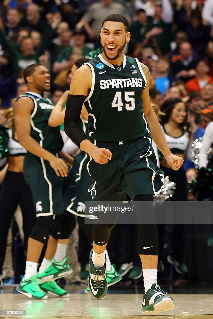 Denzel Valentine #45 of the Michigan State Spartans reacts after a basket in the second half of the game against the Oklahoma Sooners during the East Regional Semifinal of the 2015 NCAA Men's Basketball Tournament at the Carrier Dome on March 27, 2015 in Syracuse, New York.