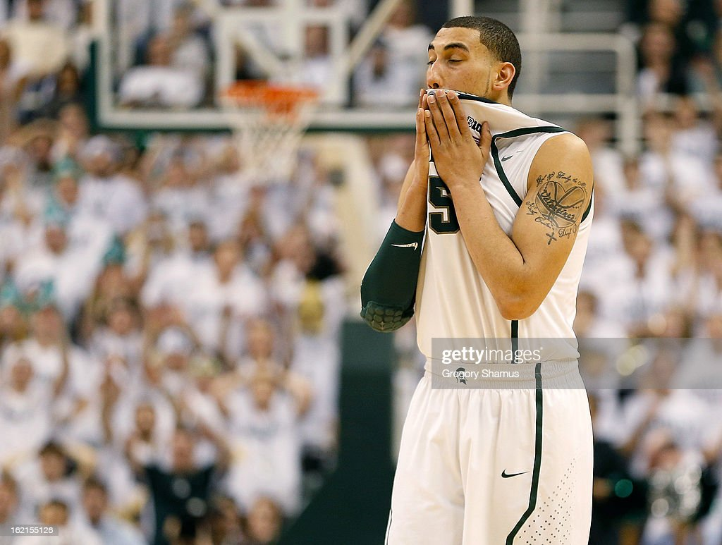 Denzel Valentine #45 of the Michigan State Spartans reacts after a missed free throw by Gary Harris #14 during the final seconds while playing the Indiana Hoosiers at the Jack T. Breslin Student Events Center on February 19, 2013 in East Lansing, Michigan. Indiana won the game 72-68.