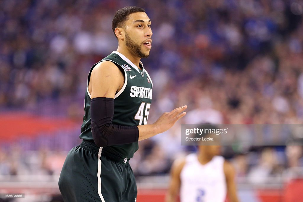 <a gi-track='captionPersonalityLinkClicked' href=/galleries/search?phrase=Denzel+Valentine&family=editorial&specificpeople=9980674 ng-click='$event.stopPropagation()'>Denzel Valentine</a> #45 of the Michigan State Spartans reacts after making a three-pointer in the first half against the Duke Blue Devils during the NCAA Men's Final Four Semifinal at Lucas Oil Stadium on April 4, 2015 in Indianapolis, Indiana.