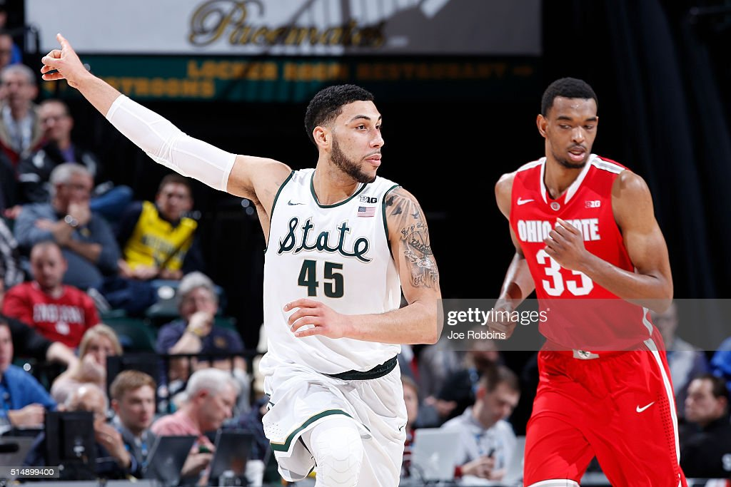 <a gi-track='captionPersonalityLinkClicked' href=/galleries/search?phrase=Denzel+Valentine&family=editorial&specificpeople=9980674 ng-click='$event.stopPropagation()'>Denzel Valentine</a> #45 of the Michigan State Spartans reacts after making a three-point shot against the Ohio State Buckeyes in the quarterfinal round of the Big Ten Basketball Tournament at Bankers Life Fieldhouse on March 11, 2016 in Indianapolis, Indiana.