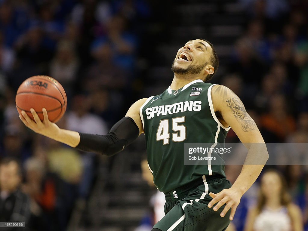 <a gi-track='captionPersonalityLinkClicked' href=/galleries/search?phrase=Denzel+Valentine&family=editorial&specificpeople=9980674 ng-click='$event.stopPropagation()'>Denzel Valentine</a> #45 of the Michigan State Spartans reacts after defeating the Michigan State Spartans 60-54 during the third round of the 2015 NCAA Men's Basketball Tournament at Time Warner Cable Arena on March 22, 2015 in Charlotte, North Carolina.