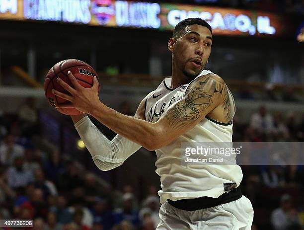 Denzel Valentine of the Michigan State Spartans rebounds against the Kansas Jayhawks during the Champions Classic at the United Center on November 17...