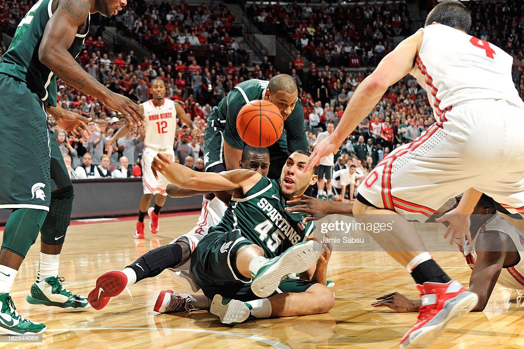 Denzel Valentine #45 of the Michigan State Spartans scrambles to gain control of a loose ball in front of Shannon Scott #3 of the Ohio State Buckeyes in the second half on February 24, 2013 at Value City Arena in Columbus, Ohio. Ohio State defeated Michigan State 68-60.