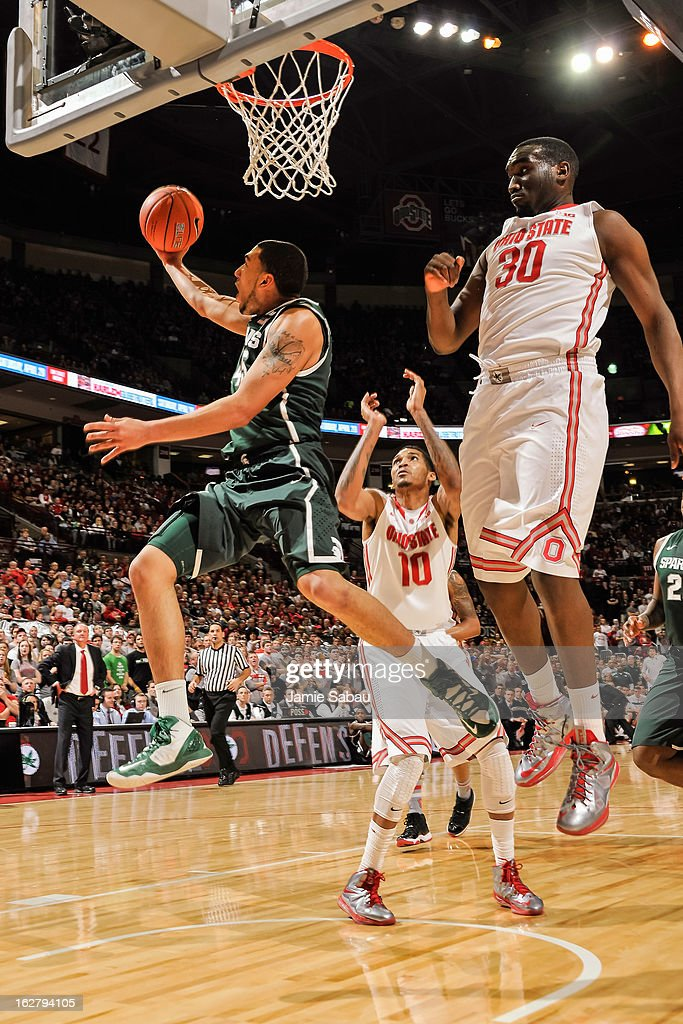 Denzel Valentine #45 of the Michigan State Spartans shoots the ball against the Ohio State Buckeyes on February 24, 2013 at Value City Arena in Columbus, Ohio.