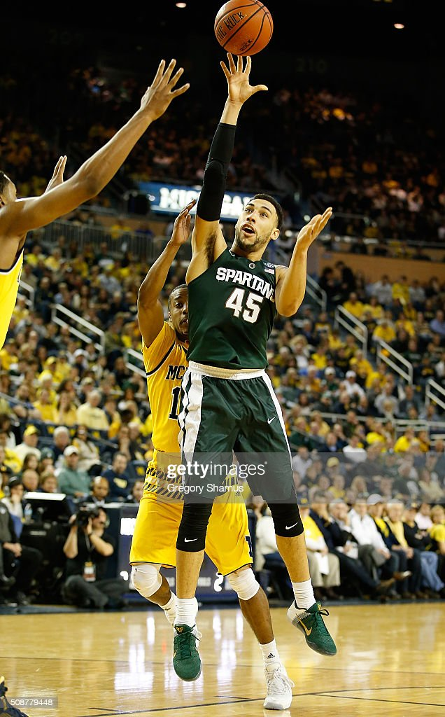 <a gi-track='captionPersonalityLinkClicked' href=/galleries/search?phrase=Denzel+Valentine&family=editorial&specificpeople=9980674 ng-click='$event.stopPropagation()'>Denzel Valentine</a> #45 of the Michigan State Spartans takes a second half shot while playing the Michigan Wolverines at Crisler Center on January 6, 2016 in Ann Arbor, Michigan. Michigan State won the game 89-73.
