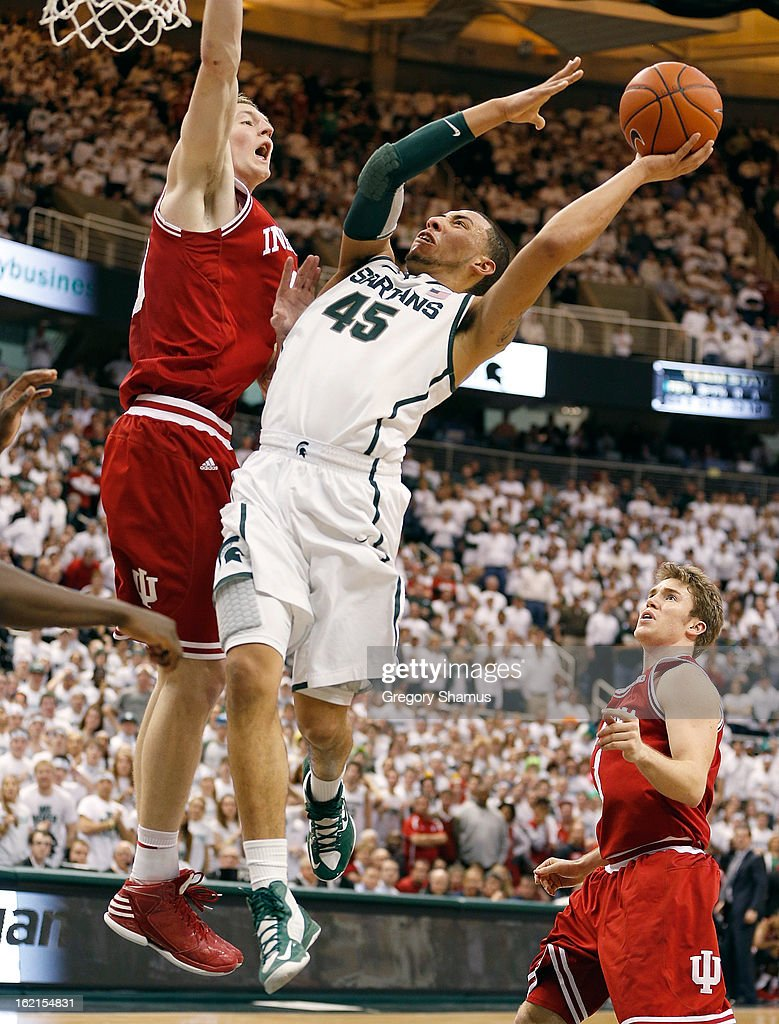 Denzel Valentine #45 of the Michigan State Spartans tries to get off a second half shot around <a gi-track='captionPersonalityLinkClicked' href=/galleries/search?phrase=Cody+Zeller&family=editorial&specificpeople=7621233 ng-click='$event.stopPropagation()'>Cody Zeller</a> #40 of the Indiana Hoosiers at the Jack T. Breslin Student Events Center on February 19, 2013 in East Lansing, Michigan. Indiana won the game 72-68.