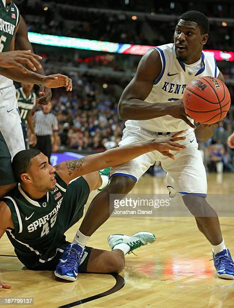 Denzel Valentine of the Michigan State Spartans tries to grab the ball away from Alex Poythress of the Kentucky Wildcats during the State Farm...