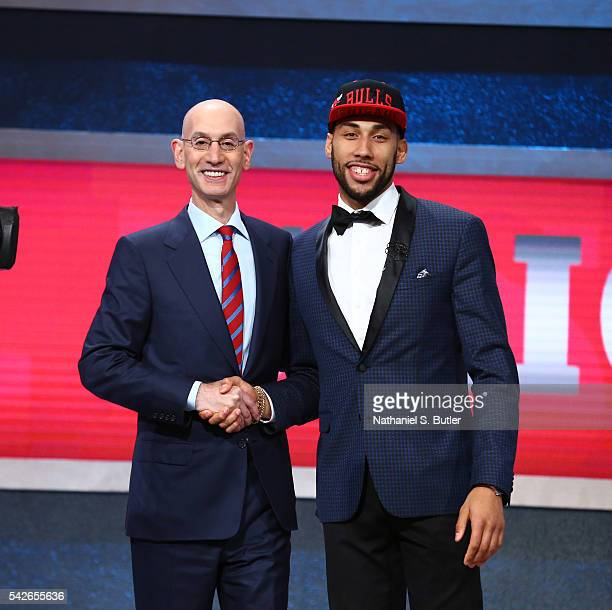 Denzel Valentine shakes hands with NBA Commissioner Adam Silver after being selected number fourteen overall by the Chicago Bulls during the 2016 NBA...