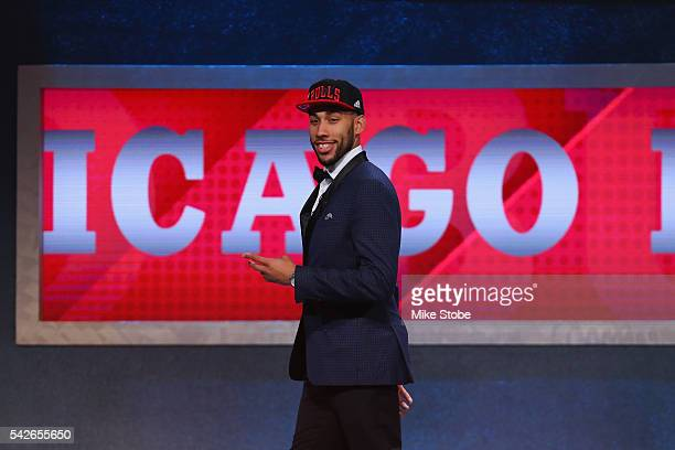 Denzel Valentine walks off stage after being drafted 14th overall by the Chicago Bulls in the first round of the 2016 NBA Draft at the Barclays...