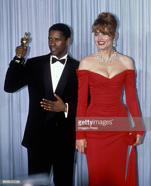 Denzel Washington and Geena Davis attend the 62nd Academy Awards circa 1990 in Los Angeles California