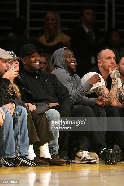 Denzel Washington and his son John David Washington attend the Los Angeles Lakers vs New York Knicks game at the Staples Center on January 29 2008 in...