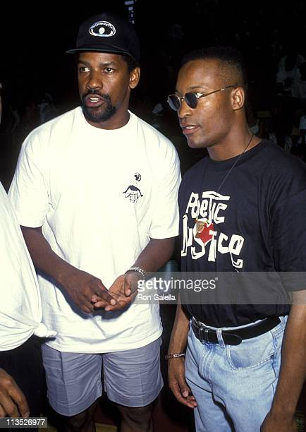 Denzel Washington and John Singleton during Celebrities vs LA Firefighters Charity Basketball Game at Loyola Marymount College in Westchester...