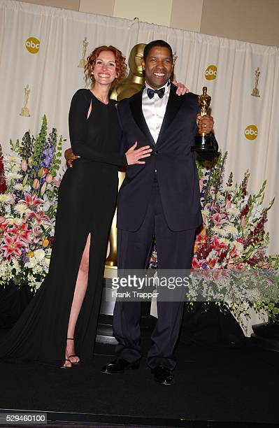 Denzel Washington and Julia Roberts in the pressroom at the 74th annual Academy Awards