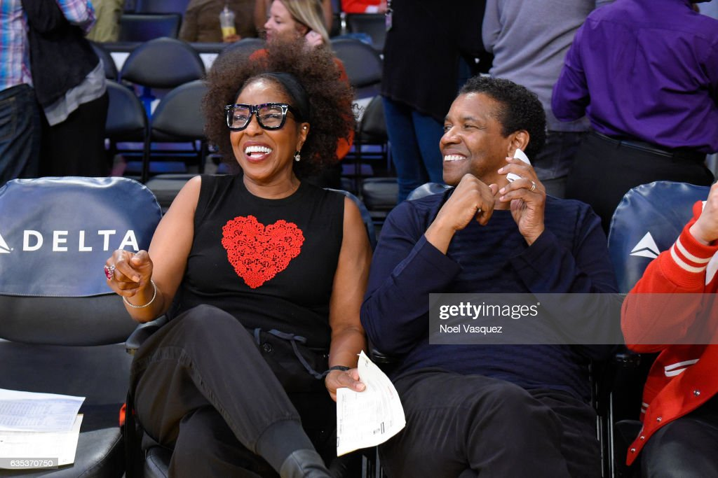 Denzel Washington (R) and Pauletta Washington attends a basketball game between the Sacramento Kings and the Los Angeles Lakers at Staples Center on February 14, 2017 in Los Angeles, California.