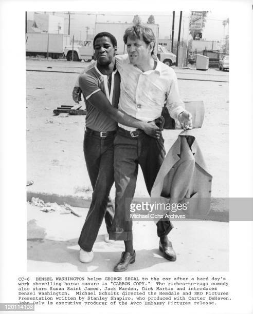 Denzel Washington helps George Segal to the car in a scene from the film 'Carbon Copy' 1981