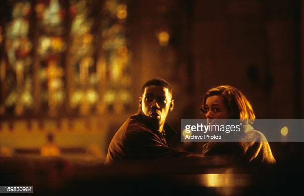 Denzel Washington quieting Embeth Davidtz in a scene from the film 'Fallen' 1998