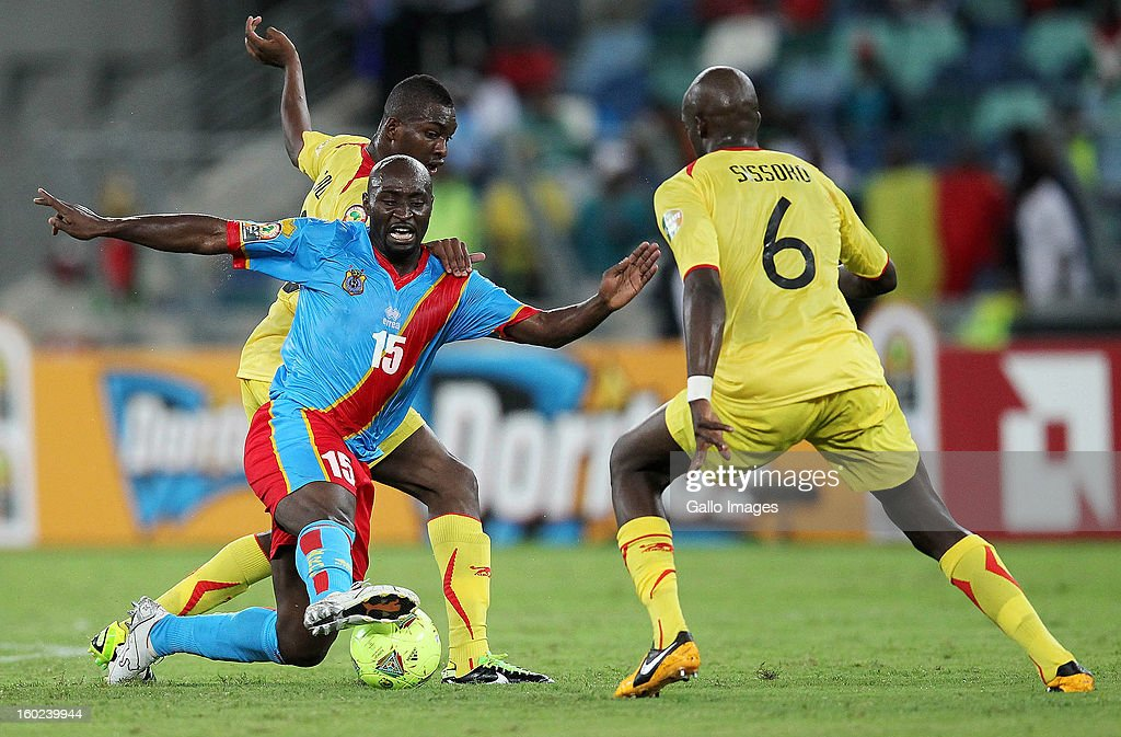 AFRICA - JANUARY 28, Deogracias Kanda Mukok of DR Congo and Mohamed Lamine Sissoko of Mali during the 2013 Orange African Cup of Nations match between DR Congo and Mali from Moses Mabhida Stadium on January 28, 2013 in Durban, South Africa.