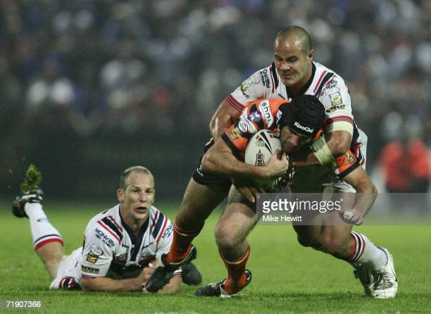 Deon Bird of Castleford is tackled by Monty Betham of Wakefield during the Superleague match between Wakefield Trinity Wildcats and Castleford Tigers...