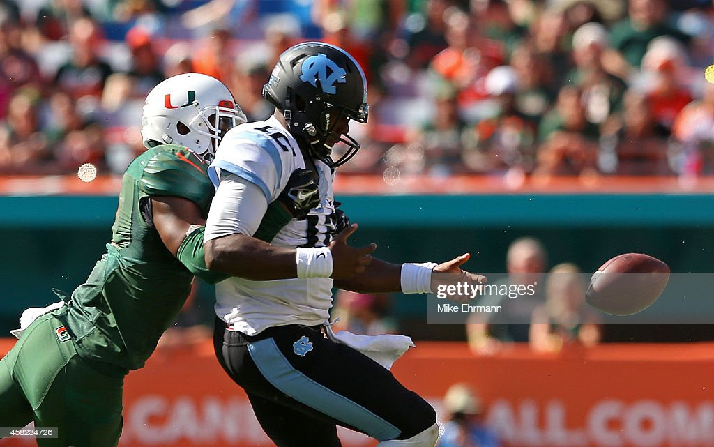 Deon Bush #2 of the Miami Hurricanes forces a fumble from Marquise Williams #12 of the North Carolina Tar Heelsduring a game at Sun Life Stadium on November 1, 2014 in Miami Gardens, Florida.